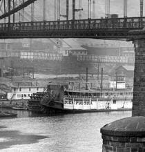 Close up of DICK FULTON under Point Bridge on Mon, circa 1900