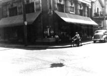 From the collection of John Dziama shows the building during the 1940s with the awnings down.  Boy on bike could be John Dziama