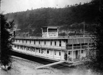 Picture of Bryant Showboat listed as being taken at Elizabeth, PA.  The location might be West Elizabeth as this is where the boat tied up during the winter for several years.  The date given of  November 14, 1928 must be date of story line and not when the photo was taken because of the appearance of leaves on the trees indicating spring or summer weather also the dress of individuals shown is light weight.