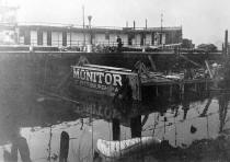 This photo is not from the same collection but shows the wreck of the MONITOR after partial dismantling