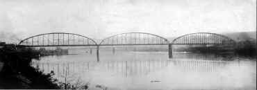 "This 1910 photograph shows the ""new"" bridge and in the background is the ""old"" bridge, as shown in previous photograph. This ""new"" bridge was replaced in 1988."