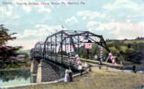 Color Version of  Pt. Marion Bridge on Cheat River Opening Day.  This bridge can be seen in next photo.
