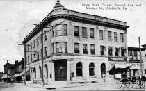Postcard showing the State Bank during the Horse and Buggy Era
