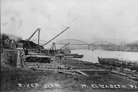 A postcard dated 1914 showing the West Elizabeth Boatyard with the Elizabeth Bridge in the background