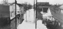 This photo is from the October 1937 flood which shows a similar scene as the previous photo, Jesters Restaurant.  It appears that Jester's moved next door, to the left, since the 1936 flood.